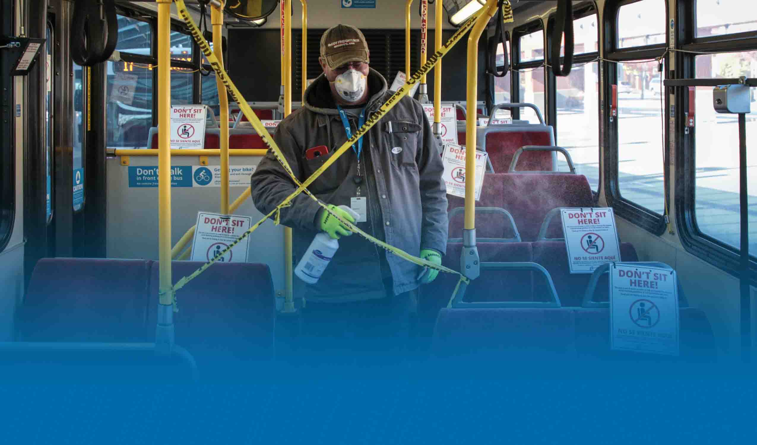 Facilities Maintenance Worker Cleaning the Bus
